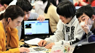 Photo of Japanese and Finnish students making projects during a Code School Finland's education camp in Oulu March 2019.